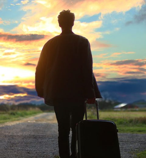 Man walking with suitcase - How to Attract the Best Guests Using an Airbnb Guest Avatar
